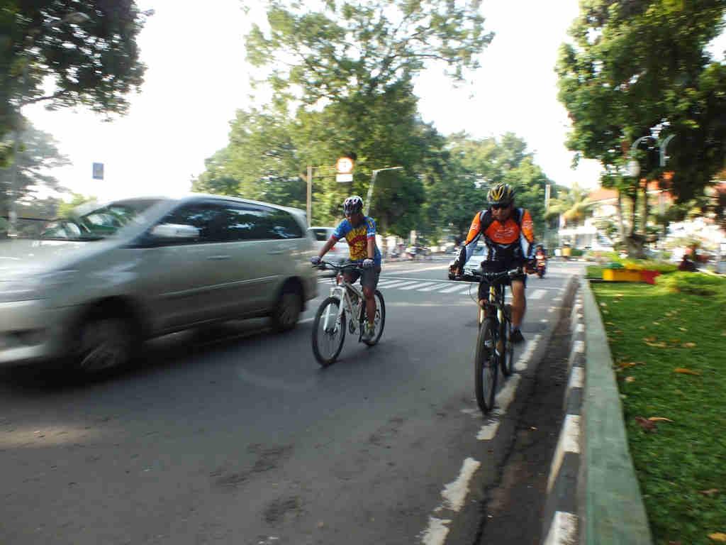 Bicycle rider on Juanda Street
