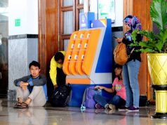 Free Smartphone Charging Booth in Commuter Train Stations b
