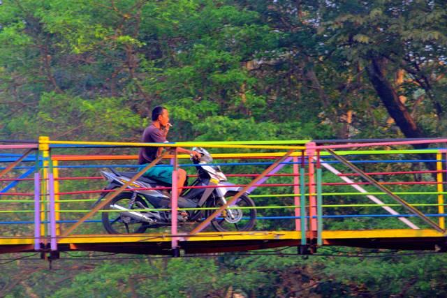 colorful suspension bridge between Sempur and Lebak Kantin a